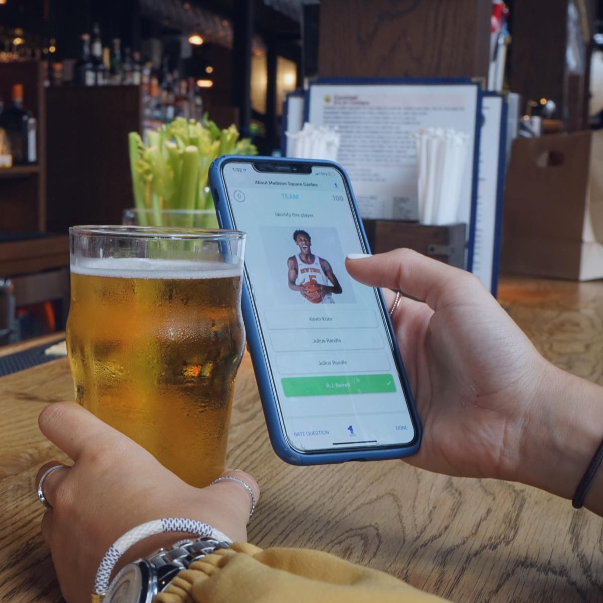 Employee at bar using 1huddle app