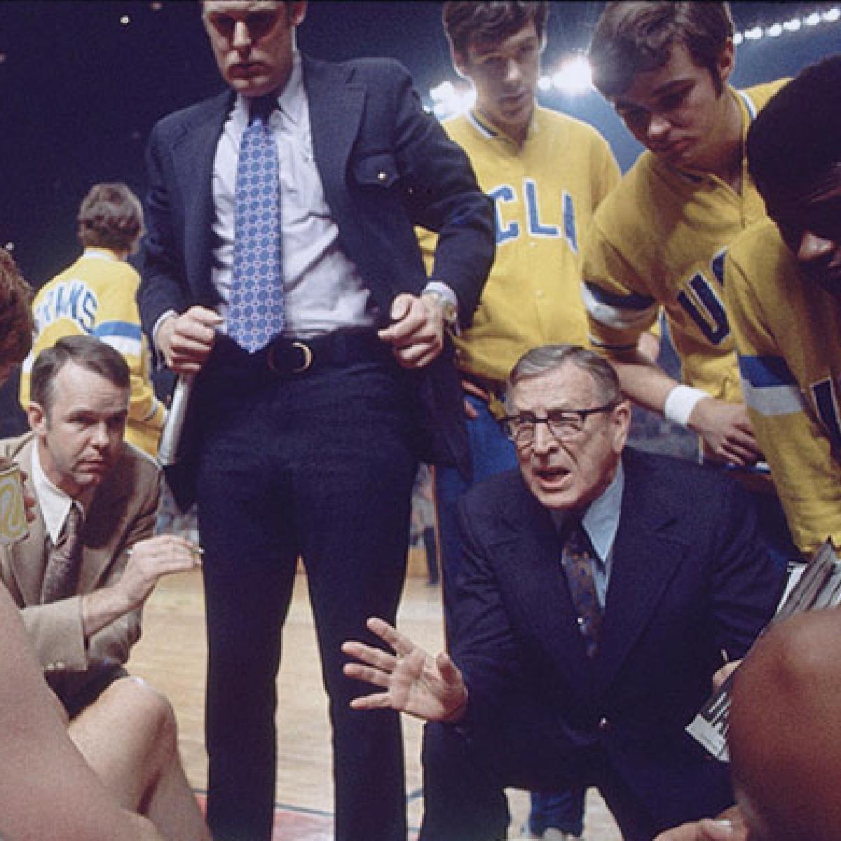 Coach leads team huddle