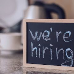 We'ra hiring notice on a small blackboard. Restaurant, cafe or bar background